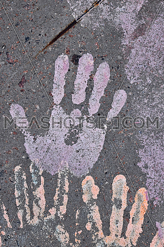 Close up human hand or palm shaped paint print on grunge concrete background