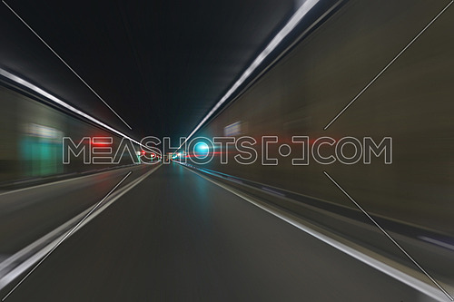Road tunnel motion blur: inside Gotthard tunnel through the Swiss Alps