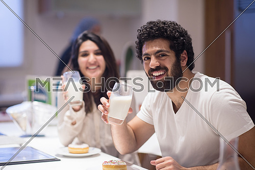 Young middle east couple eating a meal and happily spends time in the kitchen