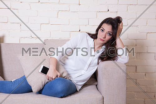 A girl sitting on a couch