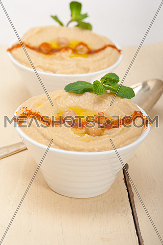 traditional chickpeas Hummus with mint olive oil and paprika on top