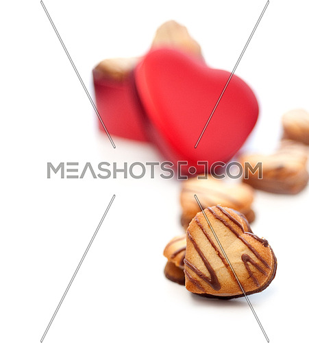 heart shaped cream cookies on red heart metal box