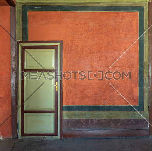 Colorful painted wall and green wooden door at the historic building of Mevlevi Tekke, Cairo, Egypt