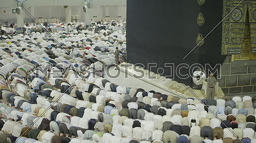 Muslim People praying at Kaaba for Pilgrimage.