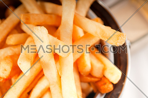 fresh french fries on a bucket extreme close up macro