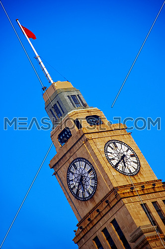 shanghai clock tower over a blue sky