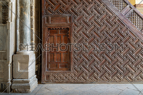 Side view of wooden Minbar (Platform) of the Mosque of Sultan Qalawun with geometrical pattern decorations and wooden door, Cairo, Egypt