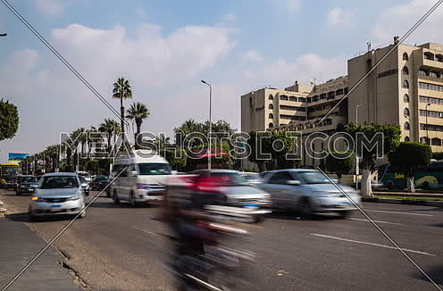 Fixed Shot for traffic at Salah Salim Street showing Le Meridien Hotel in background at Daytime