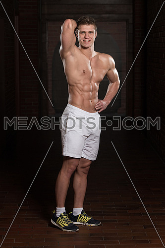 Portrait Of A Young Physically Fit Man Showing His Well Trained Body