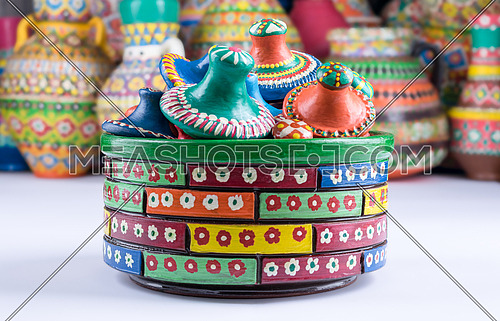 Composition of artistic handcrafted painted pottery containers