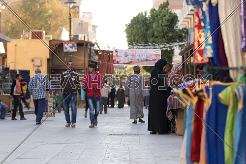 people in an outdoor market in aswan