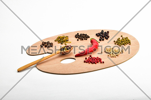 Palette of spices, collection of various spices on wooden palette isolated on white