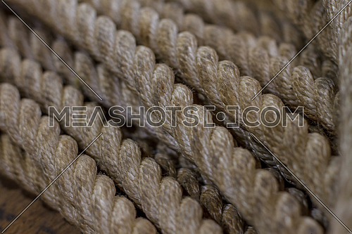 Strands of Old Strong beige rope coiled