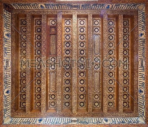 Wooden ceiling decorated with floral patterns and calligraphy at Mamluk era Prince Taz Palace situated on the intersection of Saliba Street and Suyufiyya Street, Medieval Cairo, Egypt