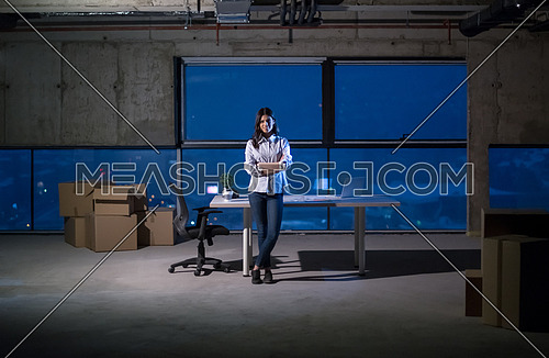 portrait of young female architect on construction site checking documents and business workflow using laptop computer in new startup office
