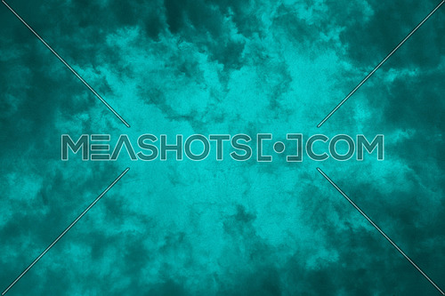Teal blue abstract grunge background with dark maroon cloudy frame and vivid center copy space