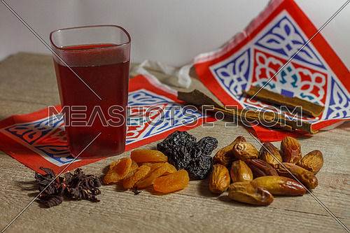 Dates, Karkade Drink (hibiscus tea)  and Ramadan Decorations on a wooden table top