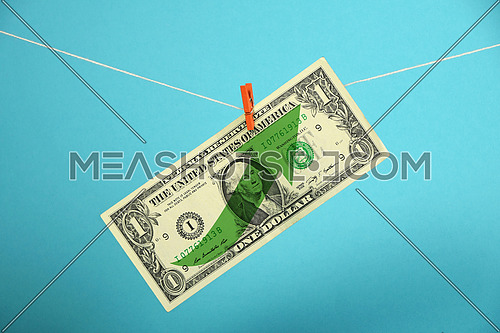 American economy growth, strengthening of US dollar, one dollar banknote with green arrow up hanged ascending with pin at rope over blue background