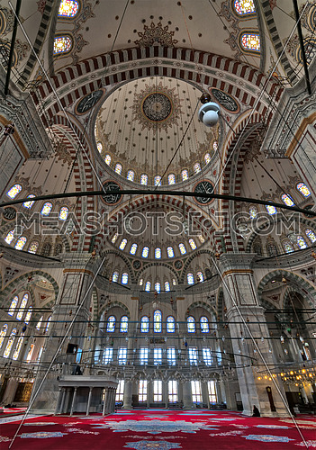 Istanbul, Turkey - April 25, 2017: Interior of Fatih Mosque, a public Ottoman mosque in Fatih district with a huge decorated domes & many colored stained glass windows