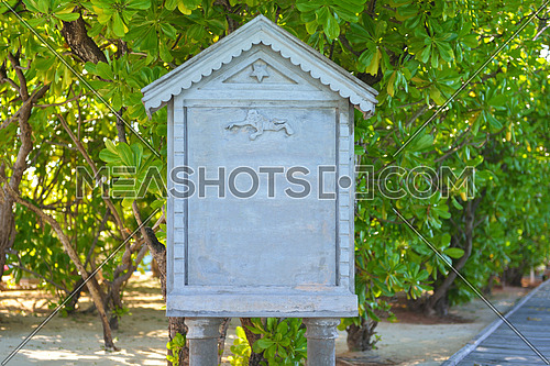 stone marble signboard  over green tropical  background