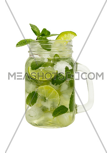 Close up one full big mason jar glass of mojito cocktail with mint leaves, lime slices and ice cubes, isolated on white background, low angle side view