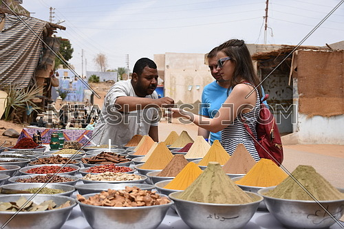 Tourists shopping for spices at the Nubian village in Aswan