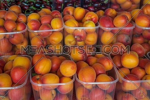 baskets of ripe apricots for sale in the steet shop.