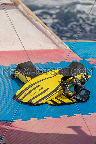 Close up shot scuba tools on yacht by day -219631 | Meashots