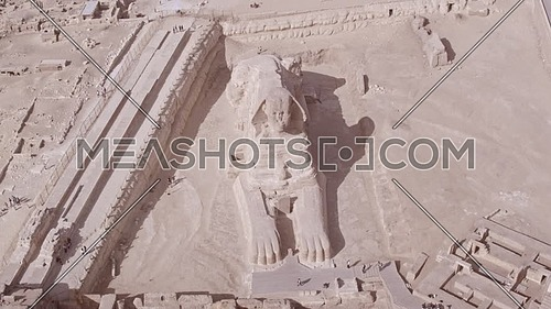 Reveal Shot Drone for The Sphinx and Menkaure Pyramid and Khafre Pyramid from Lift off top shot for the Sphinx in Giza at day