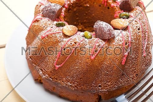 fresh chestnut cake bread dessert with almonds and pistachios on top