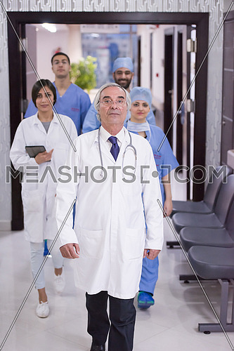 middle eastern team of doctors walking the halls of a major modern clinics