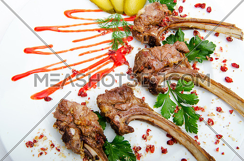 Lamb ribs served in the plate
