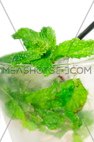 mojito caipirina cocktail with fresh mint leaves ,yerba-buena, with lime and black straw isolated on white background
