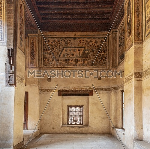 Stone wall with wooden window (Mashrabiya) and mural depicting city of Medina at ottoman historic Beit El Set Waseela building (Waseela Hanem House), Old Cairo, Egypt
