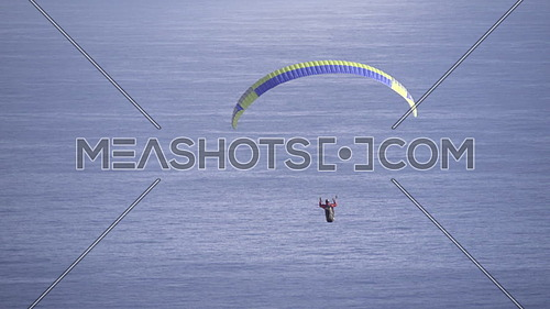 Scene of a para glider drifting in winds above Cape Town