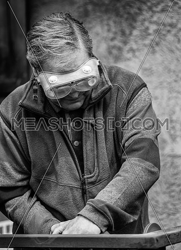 an older worker sander in Italy.