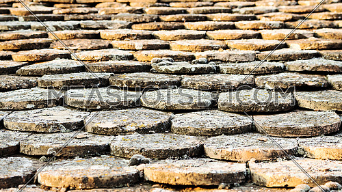 Old rustic roof tiles on the barn