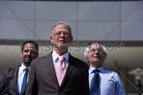 Business executives standing together