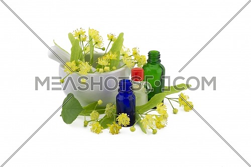 Fresh Linden or Tilia flowers and leaves with essential oil bottles in a therapeutic still life for alternative healing
