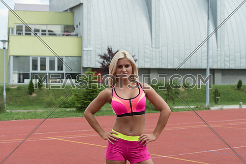 Young Woman In Sports Clothing After Outdoor Exercises