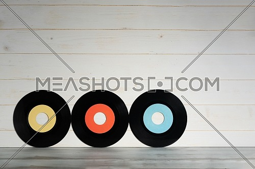 Vinyl records on wooden background,Old vintage vinyl records isolated