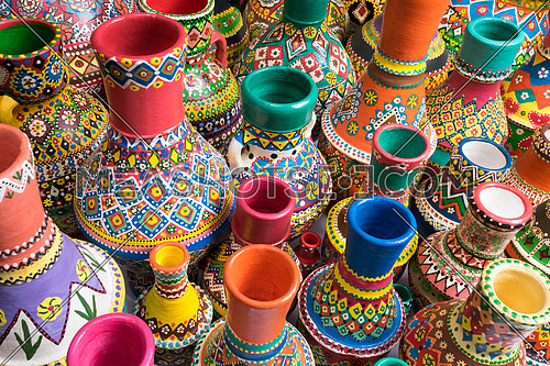 Composition of artistic painted handcrafted pottery vases