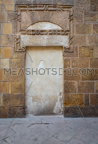 Recessed frame in an old stone bricks wall, Medieval Cairo, Egypt