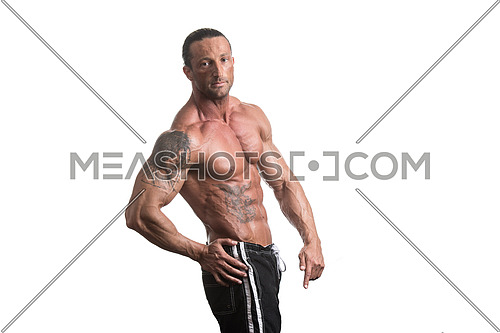 Muscular Mature Man Posing In Studio - Isolated On White Background