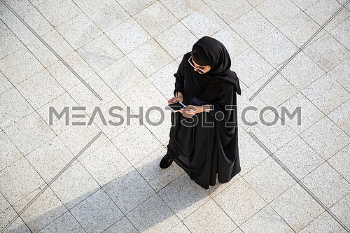 Arab lady using her phone