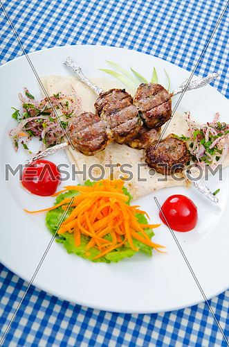 Meat cuisine - kebab served in plate