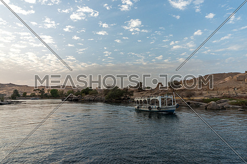 Long shot for The River Nile and a motorboat sailing show the sky clouds at day