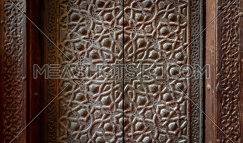Bronze-plate door ornaments at the mosque of Sultan Hassan decorated with floral and geometric patterns, Cairo, Egypt