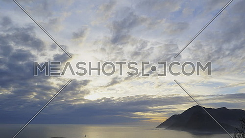 Scene of the clouds over the mouth of Hout Bay