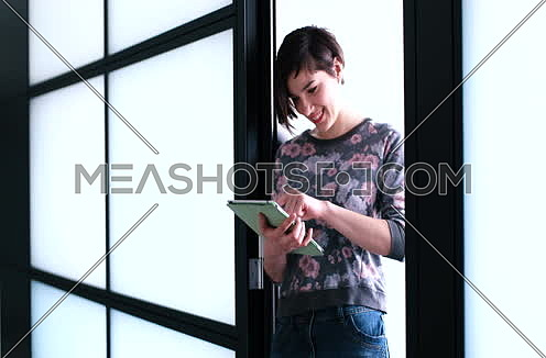 Business Woman Using Digital Tablet in front of Office